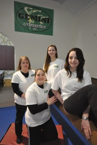 """Amy Garner, center, owner of Gemini Gymnastics, poses with her staff at 1288 Massachusetts Avenue in North Adams. Clockwise from left are Adminstrative Director Diana Bump, coaches, Olivia Griffin, Michelle Briggs and Garner. Gillian Jones — The Berkshire Eagle"""